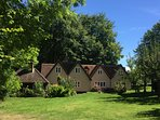 Badgers Lodge is the oak clad building to the left of the main house...