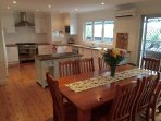 The kitchen is equipped with modern appliances including dishwasher and gas cooker.