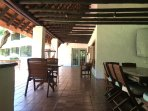 Deck area overlooking garden and forest with braai facilities
