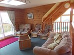 Upstairs lounge area with views out over balcony to south, Solway Firth and Lakes.