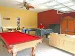 game room with pool table, foosball, air hockey, video games
