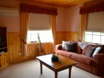 *Lounge room*  Sofa folds down to a double bed