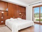 The Master bedroom with a king-size bed, and a walk-in closet