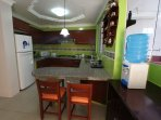 Full furnished kitchen. Fridge, stove top, coffee maker, toaster , microwave.