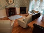 Dining Room with Log Burner, sofas and oak dining table
