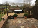 Decking area with hot tub in enclosed fenced garden