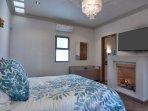 master bedroom w/queen bed, gas remote FP, ensuite bath, smart TV