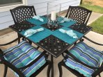 Back patio table with cushioned seating for 4.