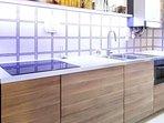 kitchen with microwave&ventilated oven, induction stove, fridge, dishwasher, washing machine