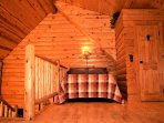 Queen bed in loft area with walk-in closet ~Wolf Ridge Retreat