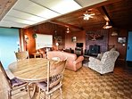 Living room with a flat screen cable TV/VCR/DVD player, wood stove, leather couch and love seat, two recliners, dining...