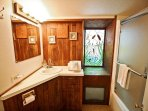 Hall bathroom with a tub/shower combo