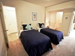 Second bedroom with two Twin bed and a split private bathroom