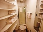 Second bedroom with two Twin bed and a split private bathroom-half bathroom with a stall shower and full size freezer