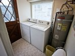 Laundry room with washer/dryer and door to backyard