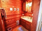 Upper unit - Lower level hall bathroom with a tub/shower combo