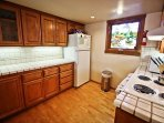 Upper unit - Lower level fully equipped kitchen with stainless steel appliances, espresso maker and a breakfast bar for...