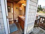 Upper unit - Lower level master bathroom with a soaker tub/shower combo and a door out to a private side deck with...