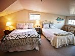 Upper unit - Upper level bedroom with a Queen and Twin bed