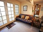 Lower unit - Living room with a flat screen cable TV/DVD player, wood burning fireplace, Queen futon for additional...