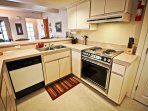 Lower unit - Fully equipped kitchen with all appliances, breakfast bar for 6 and a dining table for 4