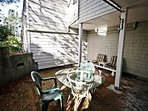 Lower unit - Private brick courtyard with a patio table for 4 and gas BBQ