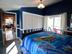Middle level master bedroom with a King bed and a slider leading to front deck