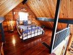 Upper level loft bedroom with a Queen bed-overlooks living area