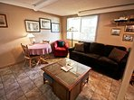 Lower level family room with a flat screen cable TV/VCR/DVD player, table for 2, hide-a-bed couch, Twin/Double bunk...