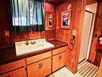 Lower level cedar bathroom with a stall shower