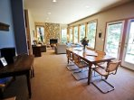 Lower level dining area for 8, I-Pod dock and french doors leading to the large golf course facing deck