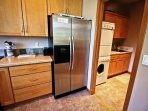 Lower level fully equipped kitchen with all appliances, large breakfast bar for 5 and golf course views-access to...