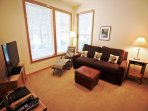Lower level family room with a flat screen TIVO TV/Blu-Ray DVD player, Double hide-a-bed for additional sleeping and a ...