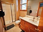 Lower level bathroom with a sit down shower and custom sink & backsplash