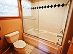 Upper level master bathroom with soaker tub/shower combo