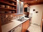 Middle level fully equipped kitchen with stainless steel appliances