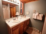 Middle level hall bathroom with a tub/shower combo
