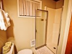 Upper level bathroom with stall shower