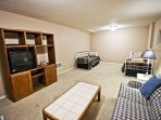 Lower level family/bedroom with Cable TV, couch, love seat and two Twin Day/Trundle beds