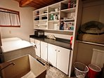 Middle level laundry room with utility sink