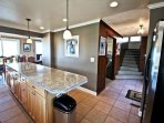 Lower level large fully equipped kitchen with stainless steel appliances and a large island with breakfast bar for 4...