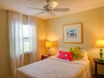 2nd bedroom - large ceiling fan and huge windows create a very relaxing Master Bedroom.