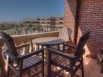 SkyRun Property - 'Weston' - Balcony Third Floor - A view overlooking the courtyard and the Gulf of Mexico,
