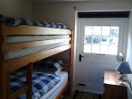 third bedroom with full size bunk beds
