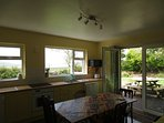 Sunny ,west facing kitchen, fully equipped opening onto patio area perfect for watching the sunset.