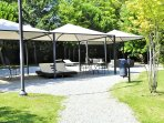 Marquees and lounge chairs offer shade and comfort