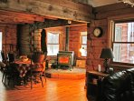 Large dining table by the cozy wood stove