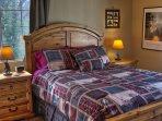 Mater bedroom has a cozy queen bed