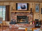 Stretch out and relax while you enjoy the 55' UHD SmartTV and wood burning fireplace