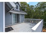 Plenty of sunshine on the upper deck and direct access to the master bedroom.